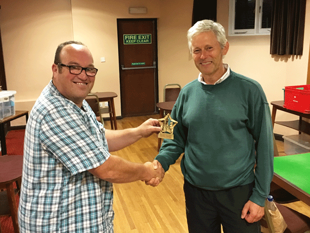 Ben Wilkinson presents the Rapidplay trophy to Steve Levy
