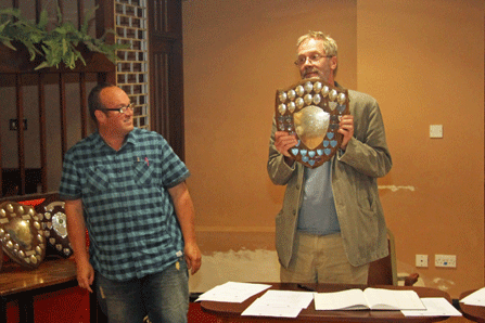 Ben Wilkinson presents the Division 1 Team Trophy to Andrew Kinder (Newton Abbot)